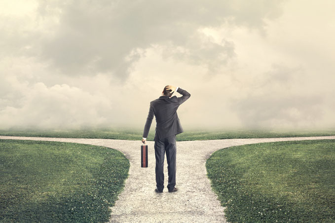 Man contemplating decision which path to take